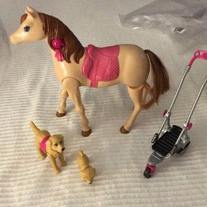 Barbies pony that moves and others